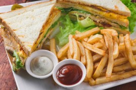 depositphotos_215357684-stock-photo-club-sandwich-served-french-fries
